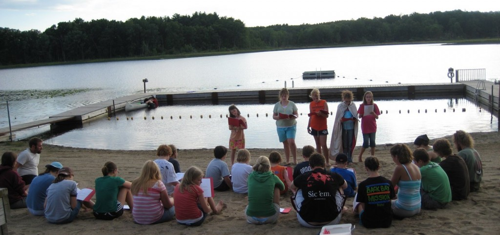 "Campers perform a play for Vespers, complete with a canoe ""Noah's Ark"""