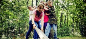 "Kids attempt the ""Islands"" obstacle on the adventure course"