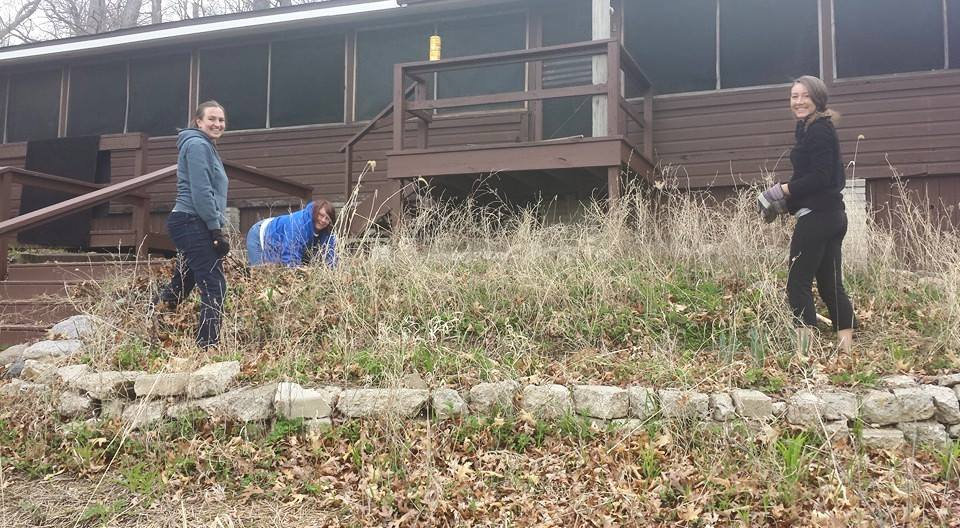 Weeding the front steps of the Lodge